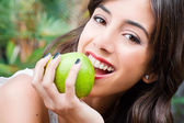 Young woman eating an apple — Stock Photo