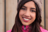 Young woman smiling and wearing a beanie — Stock Photo