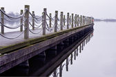 Wooden jetty on a cold lonely morning — Stock Photo