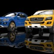 Stock Photo: Blue And Yellow 4x4 Cars On Black Background