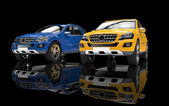 Blue And Yellow 4x4 Cars On Black Background — Stock Photo