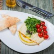 Plate with hummus dip and tapas — Stock Photo