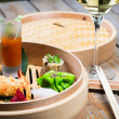 Stock Photo: Dimsum Hagao in chinese bamboo basket. Gyoza.