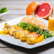 Sweet sushi roll on white plate with mango sauce. — Stock Photo