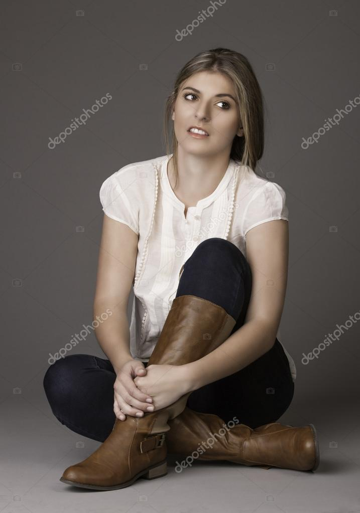 Beautiful Natural Young Woman In Boots Sitting Cross