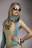 Beautiful blonde woman with sunglasses and turquoise neckscarf — Stock Photo