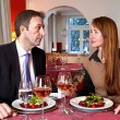 Man and woman staring at each over a meal — Stock Photo #29495025