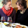 Two women chatting in restaurant — Stock Photo
