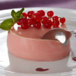 Stock Photo: Creamy vanilla pannacotta with red currant flavouring