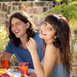 Happy young couple dining outdoors — Stock Photo #29777183