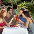 Group of friends enjoying a meal outdoors — Stock Photo #29777193