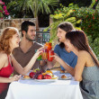 Group of friends enjoying a meal outdoors — Stock Photo