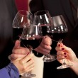 Clinking glasses with red wine. — Stock Photo #29777691