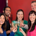 Group of multiethnic friends celebrating. — Stock Photo