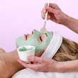 Beautician applying a thalasso face mask. — Stock Photo #29778351