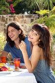 Happy young couple dining outdoors — Stock Photo
