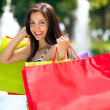 Young woman with full of shopping bags. — Stock Photo #29781581