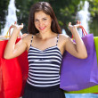 Young woman with full of shopping bags. — Stock Photo