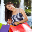 Young laughing woman shopping in summer. — Stock Photo