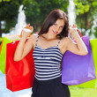 Young happy female shopping. — Stock Photo