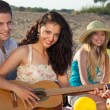 Romantic couple and two female friends on the beach — Foto Stock