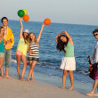 Young People Enjoying a Summer Beach Party, dancing. — Stock Photo