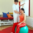 Foto Stock: Physiotherapist Exercising With Patient
