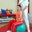 Stock Photo: Physiotherapist Exercising With Patient