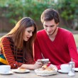 Stock Photo: Young couple having coffee