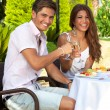 Romantic couple enjoying an outdoor meal — Stock Photo