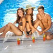 Friends enjoying drinks at the pool — Stock Photo