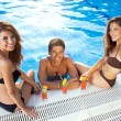 Happy man between two women at the swimming pool — Stock Photo #29785401