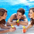 Guy flirting with two women at the swimming pool — Stock Photo