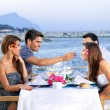 Two couples celebrating at the sea — Stock Photo #29785419