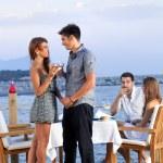 Young romantic couple celebrating — Stock Photo