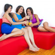 Three cute girlfriends laughing and having fun at home. — Stock Photo