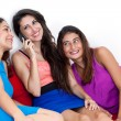 Three beautiful young women with a smart cell phone. — Stock Photo