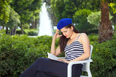 Young attractive female reading book. — Stock Photo