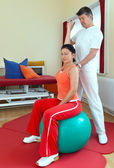 Physiotherapist Exercising With Patient — Stockfoto