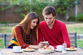 Young couple having coffee — Stock Photo