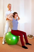 Adult practicing poses on exercise ball — Stock Photo