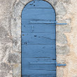 Small rounded ancient door — Stock Photo
