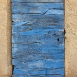 Old door, built up from timber, blue colored. — Stock Photo