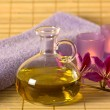 Etheric oil, candles and purple towel. — Stock Photo