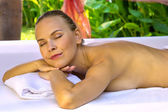 Smiling pleased female enjoys in spa. — Stock Photo