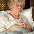 Senior woman resting in bed — Stock Photo