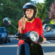 Angry old lady on a scooter making a rude gesture — Stock Photo