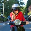 Old lady on scooter making rude gesture — Stock Photo #34306351