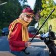 Bad tempered old woman on a scooter — Stock Photo #34306375
