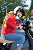 Senior woman riding her scooter — Stock Photo